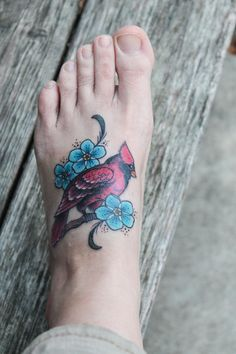 """My 2nd tattoo. The cardinal is our """"sign"""" after losing Matt, my 16yo. son, 3 years ago. He loved to watch birds and knew every one. His favorites were the Indigo Bunting and the Cardinal. The flowers are Forget-Me-Nots in Matt's favorite shade of blue."""