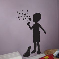Little Boy blowing Bubbles with his puppy - Wall Decals