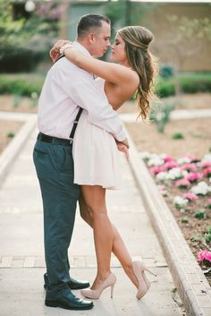 absolutely SWOONING over my bestie's newly posted engagement photos! such a gorgeous, modern, classy bride!!!!!!!! AHHHH suspenders, nude pumps, half up hair, low back dress. perfection