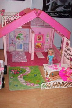 Barbie Fold N Fun House. Really digging that Rose McGowen poster in the background! lol