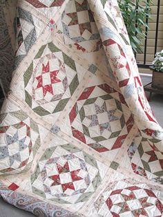 "Have you seen Rosettes? Our classic and vintage Christmas quilt was made using fabrics from the beautiful ""Sentiments"" collection by 3 Sisters for Moda. The pattern is Rosettes by Fig Tree Quilts. Kits available at www.hollyhillquiltshoppe.com"