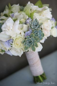 Bridal bouquet with succulents wrapped in antique lace. Coordination by Mint Julep Social Events.