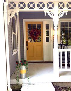 Farmhouse porch Dovetail gray exterior and mustard door