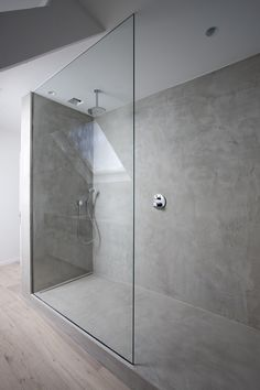 Minimal concrete walk-in shower