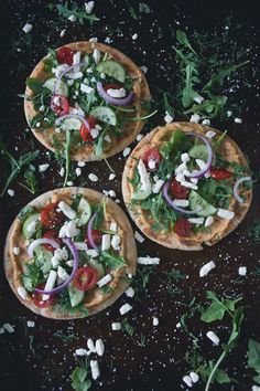 These greek salad hummus pita pizzas are the perfect summertime appetizer or main course meal. Olive oil grilled pita topped with spicy hummus and fresh Greek salad. You're going to love this!