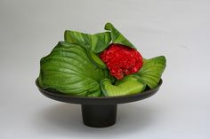 Ikebana emphasizing the surface of leaves by sogetsudc, via Flickr