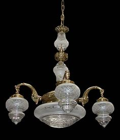 Beautiful antique 19th C. bronze chandelier with cut crystal shades and center bowl.