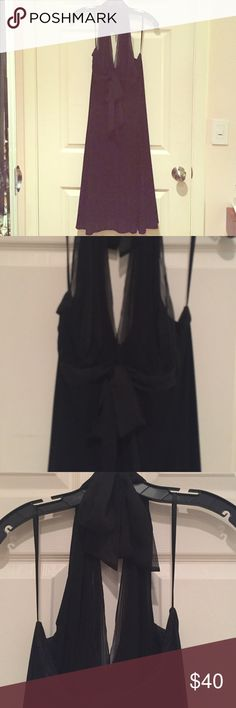 BCBG MaxAzria Black Halter Cocktail Dress. Size M. EUC! Only worn 3 times. Black Halter flowy dress. Halter has a chiffon overlay and bow almost creating a loose empire waist. Great for cocktail parties, weddings, or any dressy event. BCBGMaxAzria Dresses