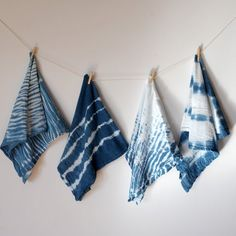 Learn how to indigo dye these adorable dish towels using the shibori method. They will brighten up your kitchen in no time.