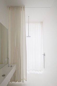 Soft drapes for shower privacy | Berlin Apartment by Atheorem