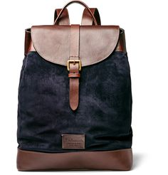 Anderson's backpack has been crafted at the brand's workshop in Parma, Italy, from supple navy suede with brown leather panels on the top, back and base for added structure. It's further reinforced by the full canvas lining and equipped with zipped and pouch internal pockets for storing your essentials.
