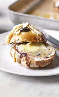 These cherry and almond hot cross buns are a must-try recipe this Easter. With studs of melted marzipan and tart sour cherries, what's not to love?