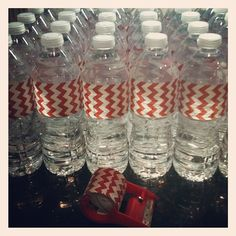 Cheapest, easiest DYI water bottle labels using Scotts decorative packing tape. One role on sale for 2.49 at Target….covered 35 ½ liter bottles with tape left over. Awesome!!