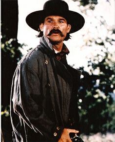 KURT RUSSELL IN TOMBSTONE Buena VistaRole: The famed lawman Wyatt EarpBest line: I spent my whole life not knowing what I want out of it, just chasing my tail. Now for the first time I know exactly what I want and who thats the damnable misery of it. Kurt Russell Tombstone, Tombstone Movie, Tombstone Quotes, Tombstone 1993, O Cowboy, Goldie Hawn Kurt Russell, Movie Stars, Movie Tv, Wyatt Earp