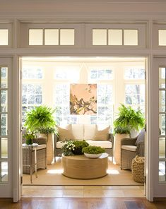 I usually like color but these pops of green help make this gorgeous! Want a sunroom like this!