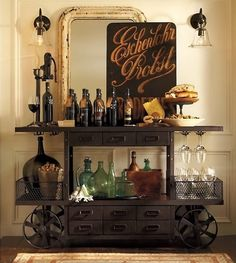 Industrial bar cart I love the cart, but I would surround it with more glam elements, like a gilded mirror, for juxtaposition.