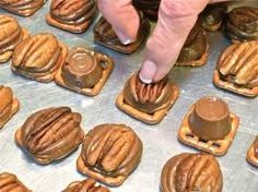 Rolo Turtles...preheat oven to 160, place any mini pretzels on parchment lined baking sheet, set a rolo on top...bake 2-3 minutes careful not to over melt the rolo, remove from oven and press a pecan half into the rolo.   *Hint: I buy the single serve rollo packs, usually found at the register, rather then the bulk pack (bags)because there's less unwrapping to do!  Options: Use candies instead of pecan; drizzle with candy melts and sprinkles.