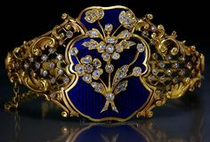 A FABERGE gold bangle bracelet influenced by French Louis XV style of the mid 18th century