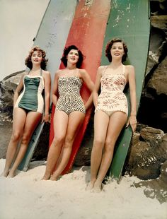 1952 Miss Pacific finalists Mary Clifton, Pamela Jansen and Judy Worrad, stand in front of surfboards on Bondi Beach, Sydney      ( National Archives of Australia )