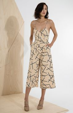 Free shipping and returns on C/MEO Collective 'Power Trip' Culotte Jumpsuit at Nordstrom.com. A strappy camisole bodice with a plunging neckline and open back is paired with knee-grazing culottes to render a geo-print jumpsuit that exudes flirty, vintage edge.