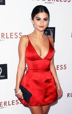 Selena Gomez stealing the show in a form-fitting satin stunner. We might have to borrow this look for our holiday party!   Click to shop holiday minis.