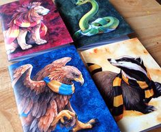 Show your house with these Hogwarts inspired themed notebooks, each featuring a wrap around illustration of mascots bedecked in thier representing colours! Each notebook is pocket A6 sized, aprox 105 x 148mm (4.1 x 5.8inches), has a glossy cover with a wrap around illustration and 48 blank or lined pages front and back inside. Seam is stapled. Four styles to choose from each notebook comes with a matching postcard sized mini-print of the cover illusration.