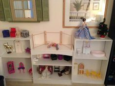 DIY Barbie dollhouse using bookshelves, WIP - these are the shelves I'm using for now, they aren't very deep so I hope to find better ones eventually. Nothing is in it's correct place, I just set some furniture in there temporarily. There's a third bookshelf that I'm going to leave both shelves in (the outside two I removed a shelf because with two in the height isn't tall enough for the dolls to go in) and its going to be all closet I think, three floors, with gowns using up 1 1/2 of the…
