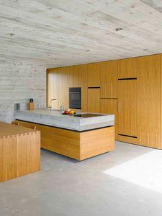 Wespi de Meuron Romeo Architetti have designed a concrete house in Sant Abbondio, Switzerland.