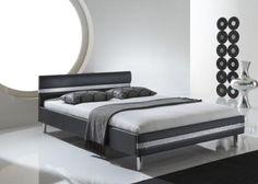 Diese interessante Polsterbett setzt mit dem Strassband im Kopf- und Fußteil moderne Akzente . Dieses moderne Polsterbett mit Kunstlederbezug bringt Sie bestimmt zum Träumen.