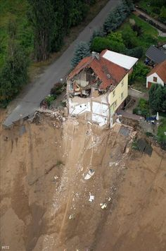 Unexpected dry mass movement is shown on the picture, in Germany. Two houses and their residents have disappeared in the hollow crater.