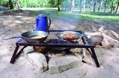 A portable grill that makes cooking over a campfire way easier.