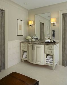 Fresh towels are easy to locate with open cubbies in this white-hued traditional master bathroom.