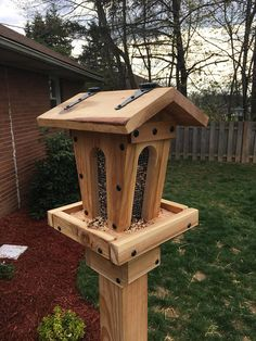 This large size all cedar bird feeder features an angled design, 1/4 wire mesh arches on all four sides for easy feed, roof top flips up for adding seed, slots for water drain off, and black hardware (can build it with silver hinges and screws-just send a note). Its stands approximately 11-12 tall and the roof is 11 wide. This feeder also uses sunflower and nut blend bird food. Post base is made to order and sold separately. Please note that this feeder is not stained or waterproofed.