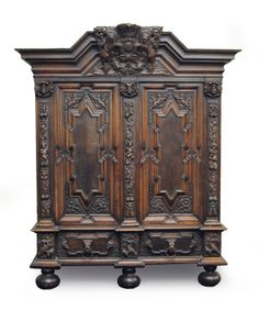 "A cabinet with a coat of arms of Gdansk    Gdansk, c. 1860/70. Wood, carved and darkened. With 2 drawers on bottom and 2 doors, framed by columns. On top coat of arms of Gdansk with inscription ""Nec Temere Nec Timide"" (neither imprudent nor fearful). Partly small traces of age. H. 245 cm, w. 210 cm, d. 63 cm."