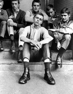 A group of skinheads sitting on the steps of Thomson House, Newcastle on 12th September 1970