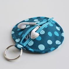 Earbud pouch on keyring- also good for a diaper bag as a paci pouch or breastpad pouch- or for school lunch money....