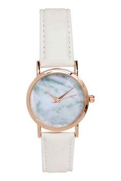 Relógio de pulso: Relógio em metal com mostrador estampado e pulseira ajustável em pele sintética com fivela de metal. Comprimento total: 22 cm. Diâmetro do mostrador: 3,2 cm.