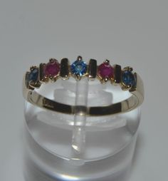 Beautiful 18K yellow gold Ring with 3 sappires 0.2ct & 2 rubys 0.13ct gemstones. Size: 7 Weight: 2.2gr. New condition. Handmade jewelry. The Ring comes in gift box.