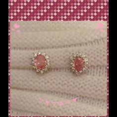 Pink sapphire earrings2 x HP Simulated pink sapphire earrings with 12 white sapphire stones surrounding the center stone. Hard to get in the pics, these sparkle so pretty! All stones are in securely. Center stone is 12 mm by 8 mm in size. Very easy to clean, regular jewelry cleaner ( I use connoisseurs) works wonderfully! Purchased from JTV. I have long hair, wore maybe twice, great for someone with a short style, or wears their hair up a lot!! Color of stone is closest to the first picture…