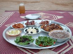 Ramadan, or Iftar, in Sudan. This is a meal for the first night with cheese, olives, sujuk, chicken, fuul, salads, and more. Yum!