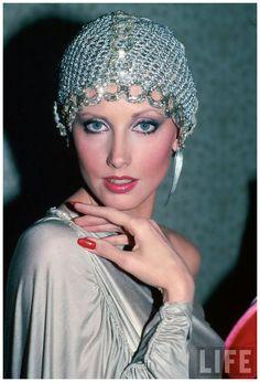 Actress Morgan Fairchild wearing mesh hat 1982