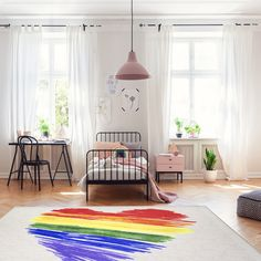 Enjoy this colorful rainbow brushstoke heart rug on a cream background to represent LGBTQ pride or to simply brighten up any room. #rugs