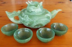 "Classic ""Dragon"" Chinese jade teapot.  Size is 10"" across, 6"" wide and 5"" high.  Substantial and heavy.  Teacups are 2"" across, 1"" high, set of 4.   Dragons are carved on each side of the teapot, and the lid features the head of a dragon.   Dragon symbolizes ""power, strength, good luck and fortune"". Dragon Tea, Jade Dragon, Tea Pot Set, Tea Sets, Chinese Tea, Tea Service, Coffee Set, High Tea, Tea Party"