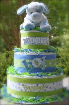 I have mixed feelings about diaper cakes. A) it's unsanitary B) you can't eat them, so that's like false advertisement  and C) you can't eat them.  However...I do like these colors together.