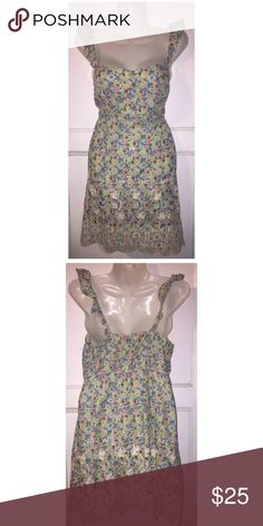 Floral Ruffle Sleeve Eyelet Dress New without tags. Size says medium but runs small. Would fit a size  4 Want and Need Dresses Mini