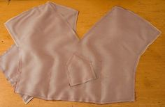 How to underline with silk organza - a perfect tutorial.   Note that it can be used if your fabric has unwanted stretch.