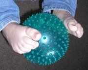 """Pass the ball from persontopersonusing onlyyour feet! The person receiving the ball has to """"catch"""" it with their feet, and so on around the circle."""