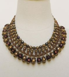 Cleopatra..a lovely statement necklace, but I an imagine it in prettier colours.
