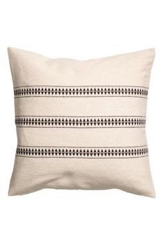 Canvas cushion cover in a cotton blend with a jacquard pattern on the front, and solid colour back in slightly thinner cotton canvas. Concealed zip.
