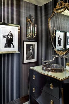 a little black goes a long way in a powder room. Love the black and white classy prints and vanity unit in glossy black. I like the thin stripe, sort of dark pin stripe. The gold really makes this small powder room a jewel! Gold Bathroom, Bathroom Interior, Bathroom Mirrors, White Bathrooms, Dream Bathrooms, Luxury Bathrooms, Small Bathroom, Modern Bathrooms, Gothic Bathroom Decor